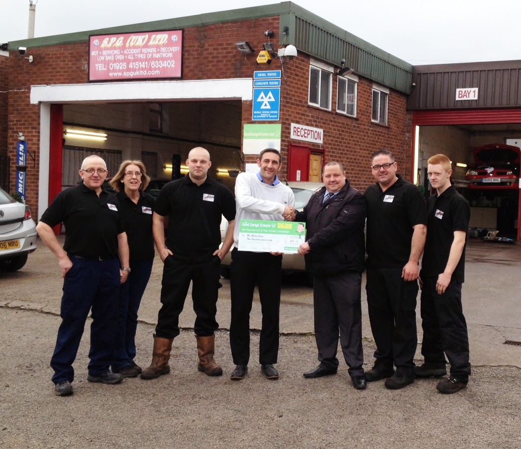 Presentation of feedback prize cheque at SPG UK Ltd garage in Cheshire
