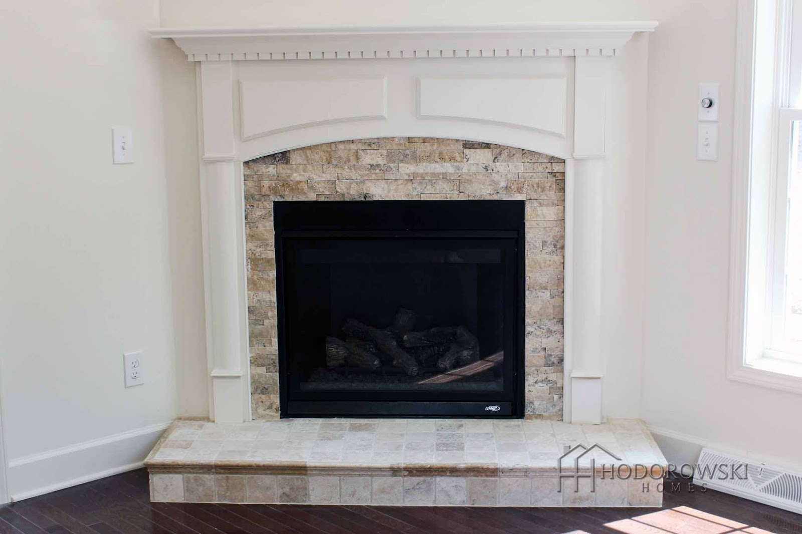hodorowski homes warm up by the fireplace