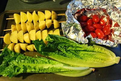Potatoes, tomatoes, and lettuce ready for the grill