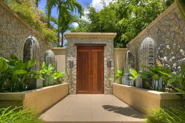 Big wooden door as an entrance to the property