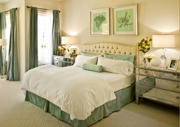 Janet Rice created a beautiful green and cream cocoon of a bedroom