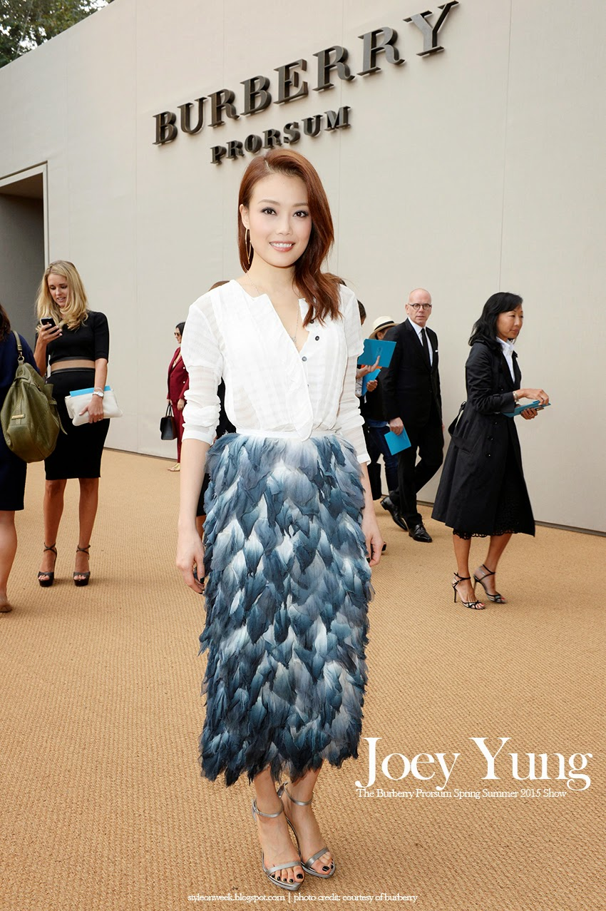 Joey Yung Look Cool Wearing Dark Stormy Blue Skirt