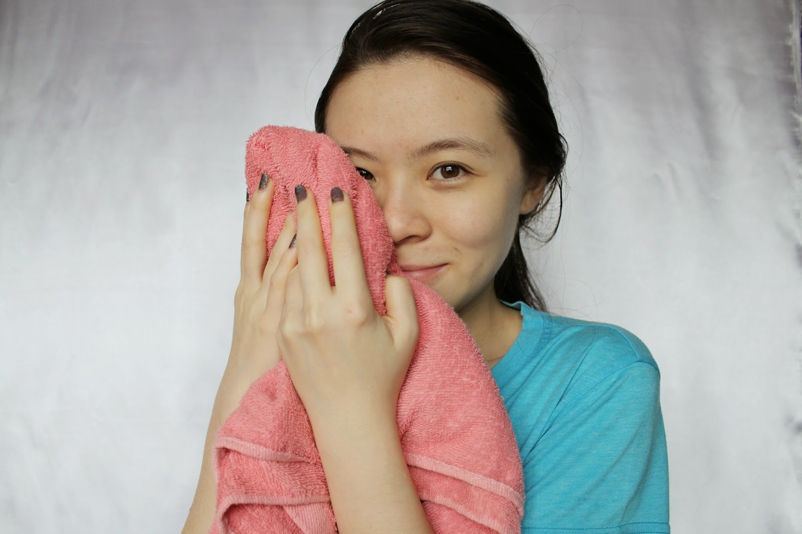 Girl holding towel