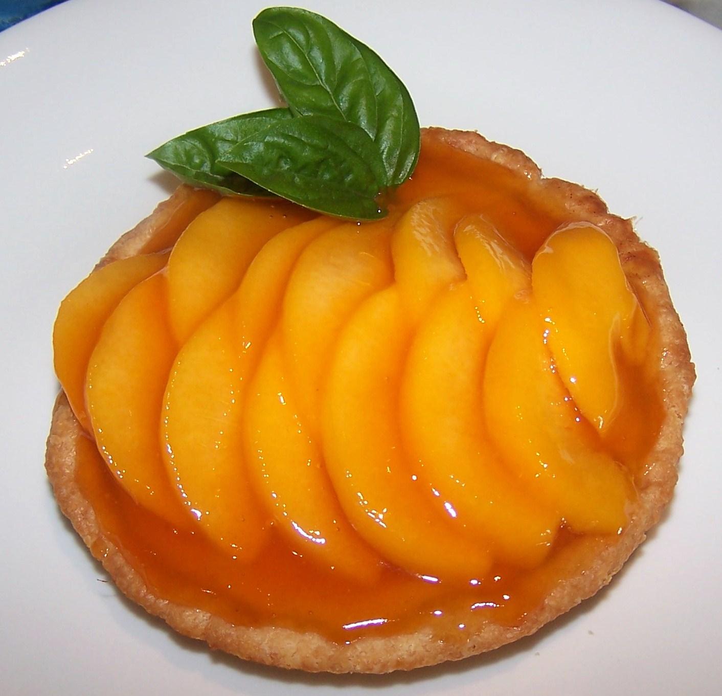 ... and below lacquered peach custard tarts luscious clingstone peaches