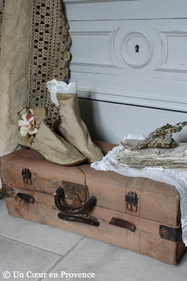 To decorate a room, a composition with a bag of old boots