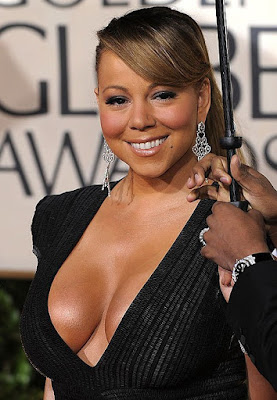 Mariah Carey considering breast reduction?  Careys-cleavage