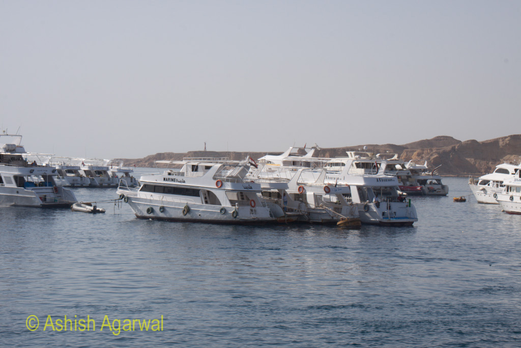 Ships and yachts in the waters of the Red Sea off Sharm el Sheikh