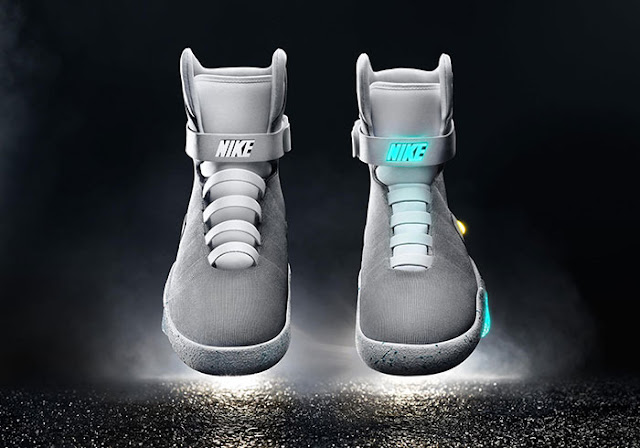 Wired explains how the self-tying shoes works. They come with a motorized system and an ankle cinching system that will use a coil spring to tighten or loosen the laces.
