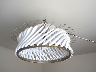 Make your own chandelier out of clothes hangers the for Build your own chandelier