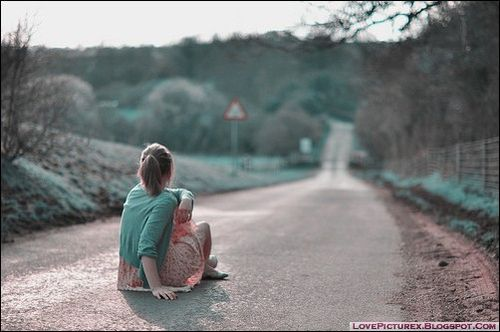 a sad girl alone