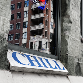 CHILL sign below tavern window.