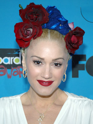 Fun braids are adorned with fresh flowers and jewel-toned ribbon in Gwen Stefani's whimsical updo.