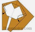Bước 13: Gấp hai cạnh giấy vào trong giữa hai lớp giấy.