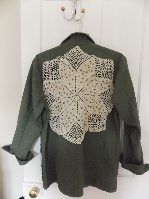 A khaki jacket with crochet detail