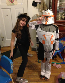 Young kids in black cat and Commander Cody costumes