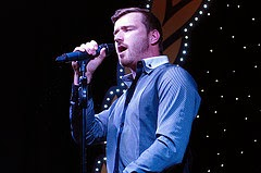 Jai McDowall singing on stage