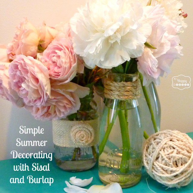 Sisal and burlap touches on plain mason jars and vintage milk bottles, by The Happy Housie, featured on I Love That Junk. Very sweet and simple!