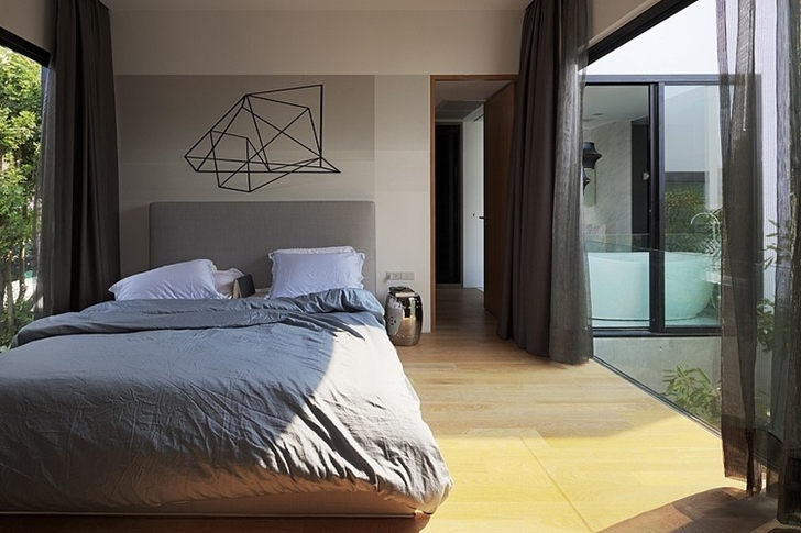 Bedroom in Modern mansion in Singapore