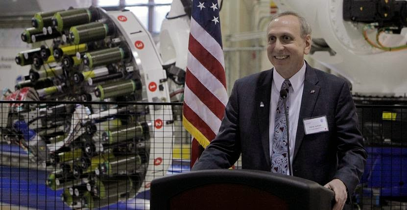 NASA Langley Center Director Steve Jurczyk speaks during the commissioning ceremony for ISAAC, a robot that will develop strong, light composite structures and materials for aerospace vehicles. Image Credit: NASA/David C. Bowman