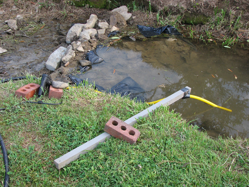 Grow appalachia finding new ways to water during the for Diy pond cleaner