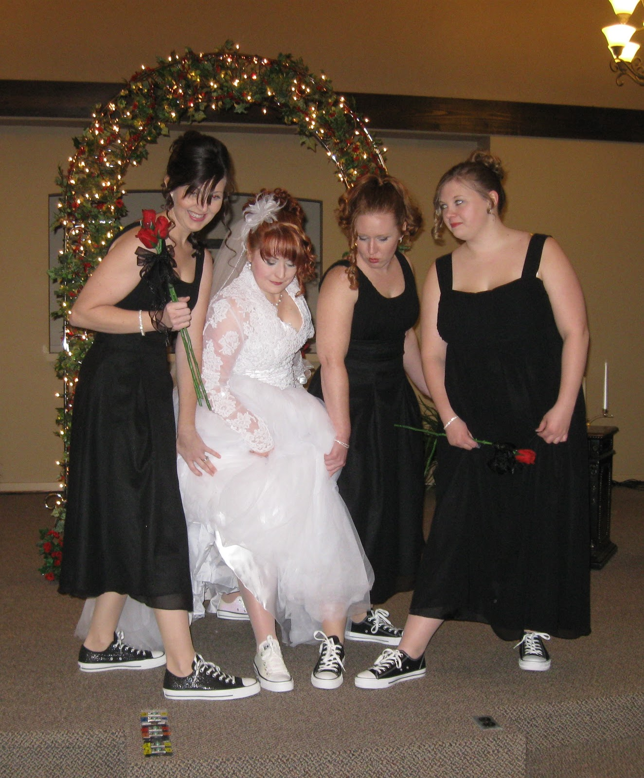 Five Beautiful Little Girls Dressed In Black White And Red The Ubiquitous Converse Foot Ware Took Care Of Rings Flowers Books