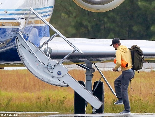 David Beckham Spotted Jetting Out Of Brazil In A Private Jet! He Looks Like One Who's Just Gone For A Picnic With His Bag On His Back!