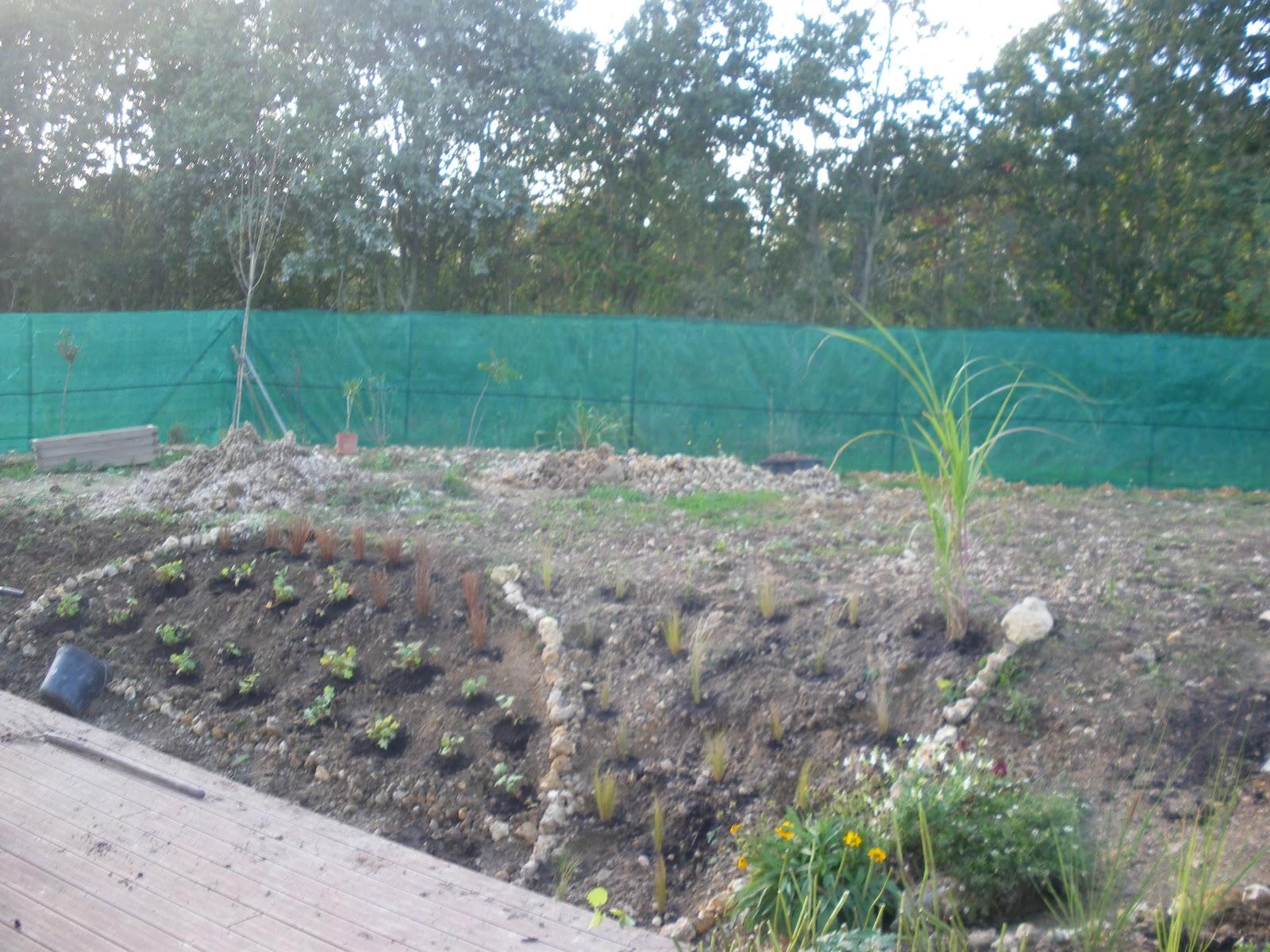 Jardin aux quatre saisons mise en place de la rocaille for Graminee geante