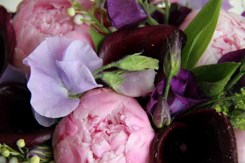 wedding bouquet in pink purple sweet peas calla lilies and peonies