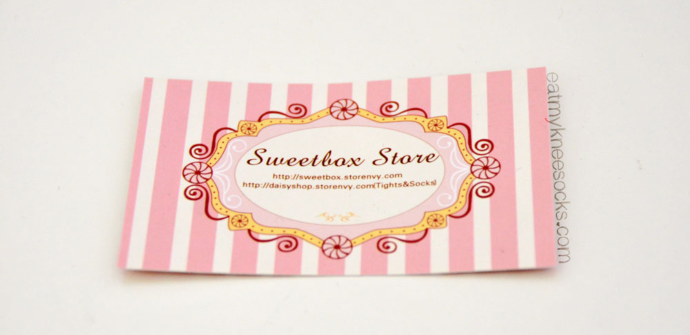 The adorable business card from Sweetbox Store, a Storenvy shop specializing in cute apparel and accessories.