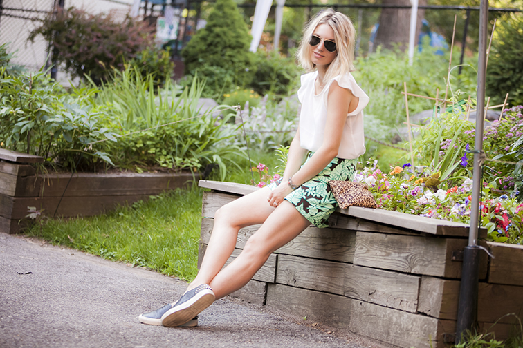 Chilling in the West Side Community Garden in New York City, silk blouse, tropical print shorts, leopard print pouch, slip-on sneakers, Joe Fresh, Zara, J.Crew, Sandro, Ray-Ban, vintage jewelry