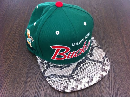 Snakeskin snap back hats.