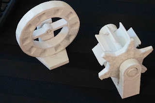 Picture of toy ferris wheel and gear, both 3D printed