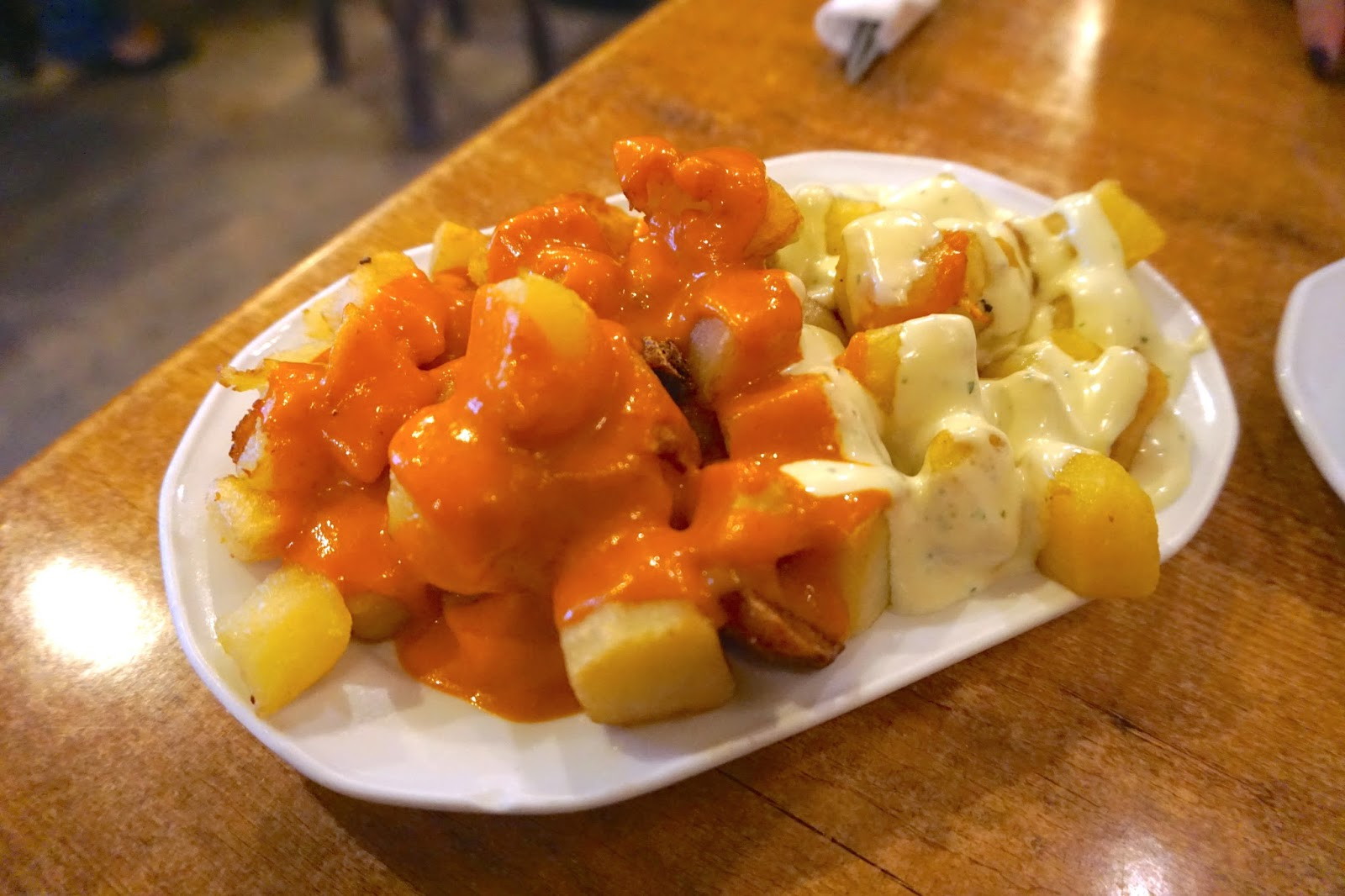 Patatas Bravas at a tapas restaurant with patatas bravas sauce and mayo
