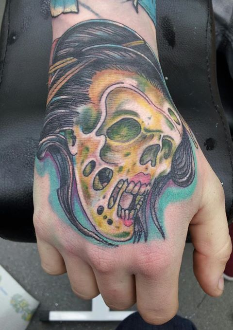 Side of hand tattoos