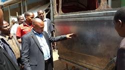 Richard Muteti CEO Jua Kali Federation inspecting Vehicle body building skills