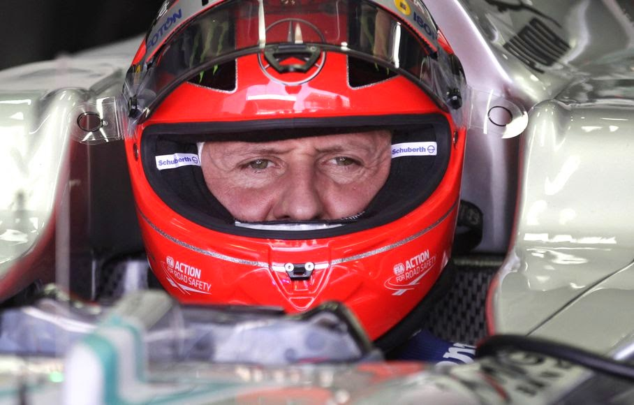 In this Nov. 23, 2012 file photo, Grand Prix driver Michael Schumacher, of Germany, sits in his car during a free practice at the Interlagos race track in Sao Paulo, Brazil. Formula One great Michael Schumacher is no longer in a coma and has left a French hospital where he had been receiving treatment since a skiing accident in December, his manager said Monday June 16, 2014.