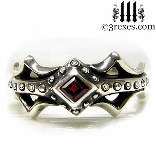 fairy princess silver engagement ring with gothic red garnet