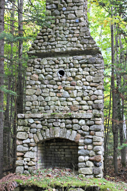 Stone fireplace in the woods of the Adirondack Mountains - www.goldenboysandme.com