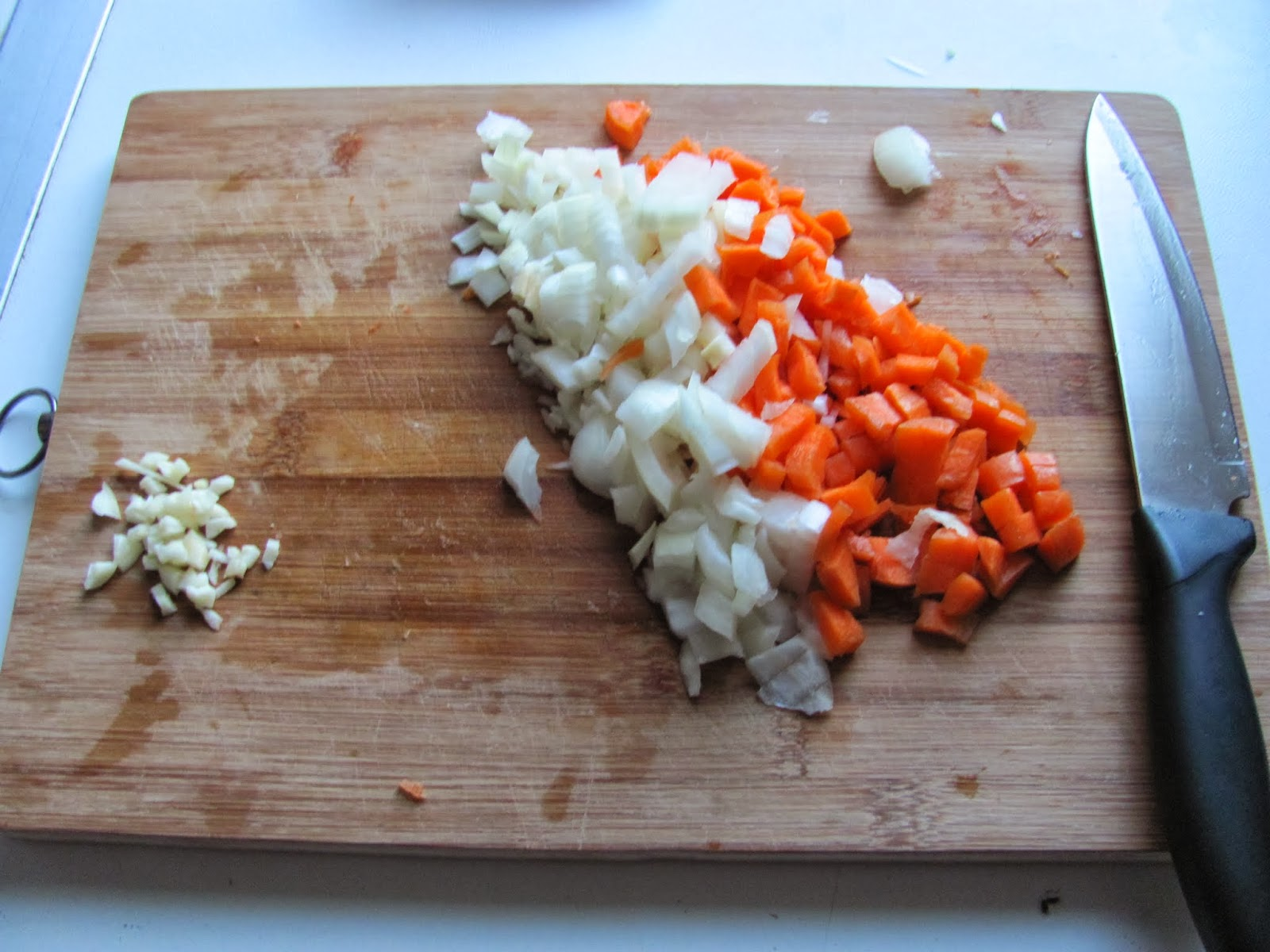 Carrots, onion, and garlic chopped for sauce
