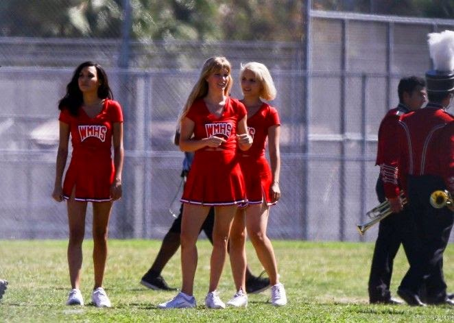 Dianna Agron displayed her slim legs in a red cheerleader dress during her job as actress for Glee episode with Heather Morris and Naya Rivera at Los Angeles on Monday, September 22, 2014.