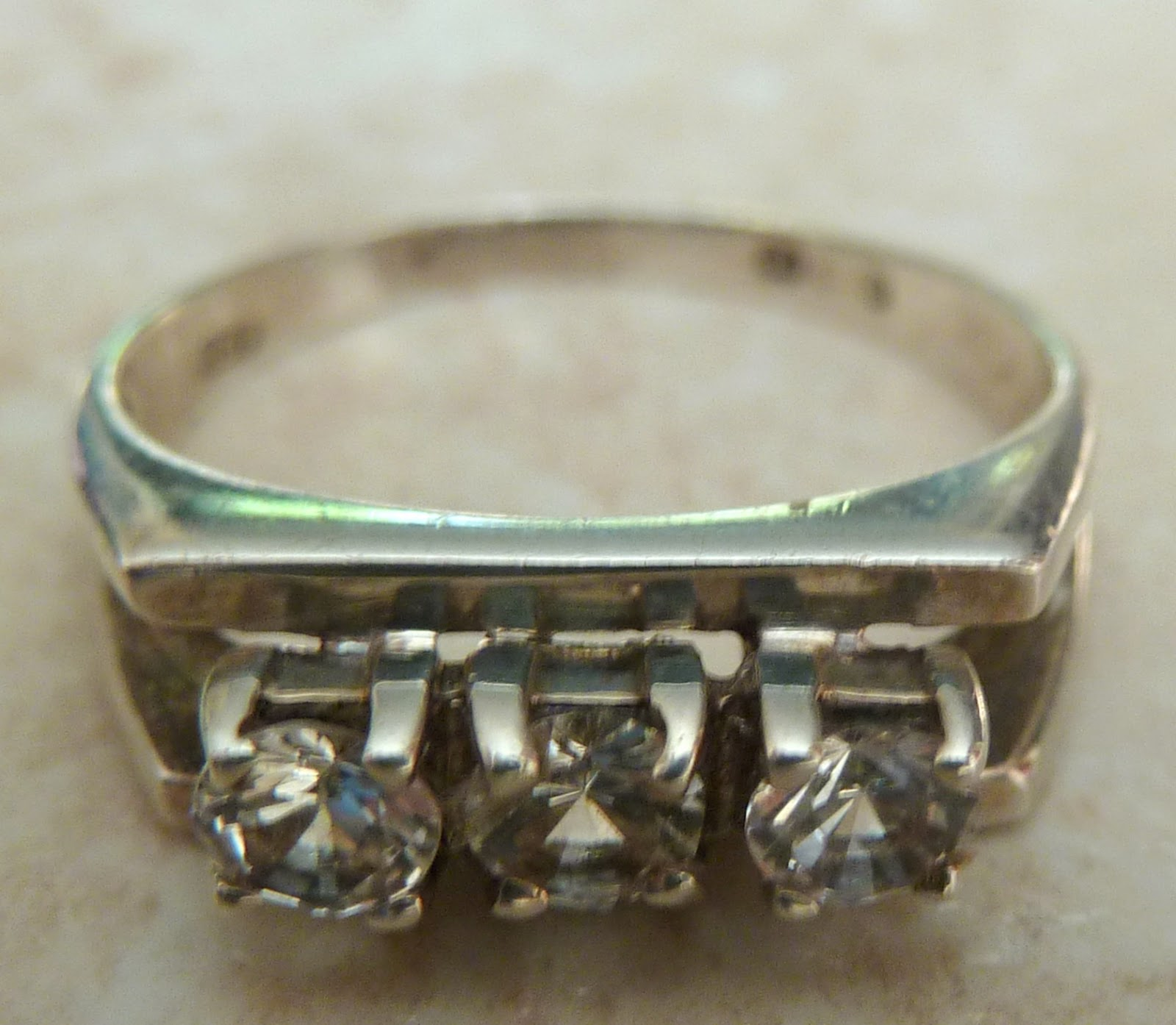 http://www.kcavintagegems.uk/vintage-sterling-silver-and-zirconia-modernist-style-ring-360-p.asp