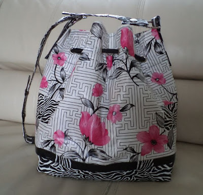 Repairing my waxcloth bucket bag with duct tape