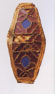 A unique sixth-to seventh-century A.D. inlaid garnet and lapis lazuli bead, made in two parts by a master Anglo-Saxon jeweler.