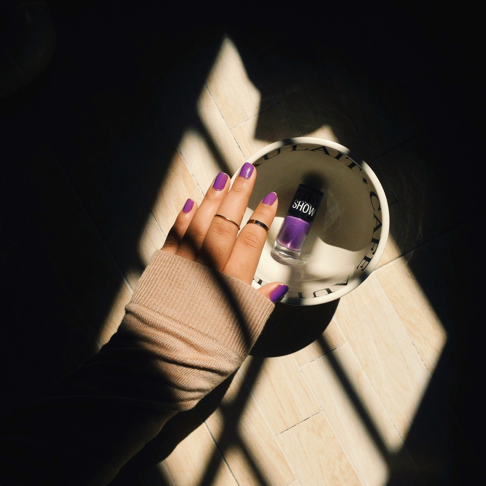 This image shows freshly manicured nails, painted in Lavender Lies from Maybelline Color Show