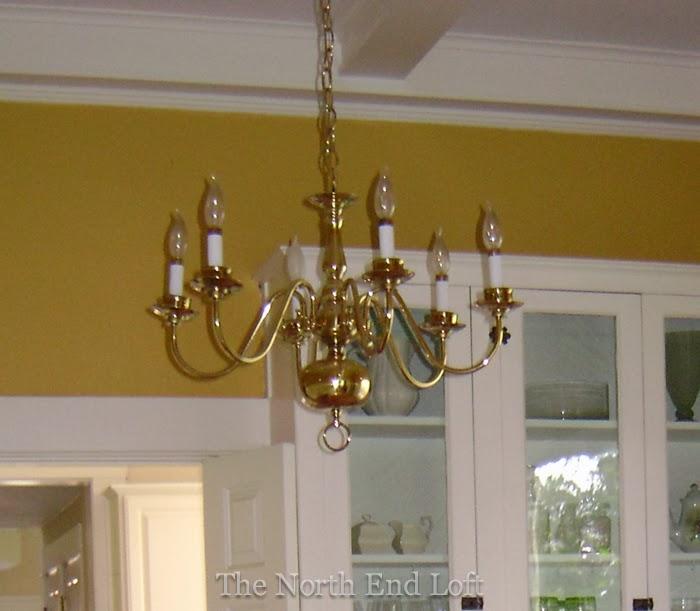The north end loft spray painting a 1990s brass chandelier this was the inexpensive brass chandelier we bought for our dining room around 1990 these fixtures were very popular back then for traditional dining rooms aloadofball Image collections