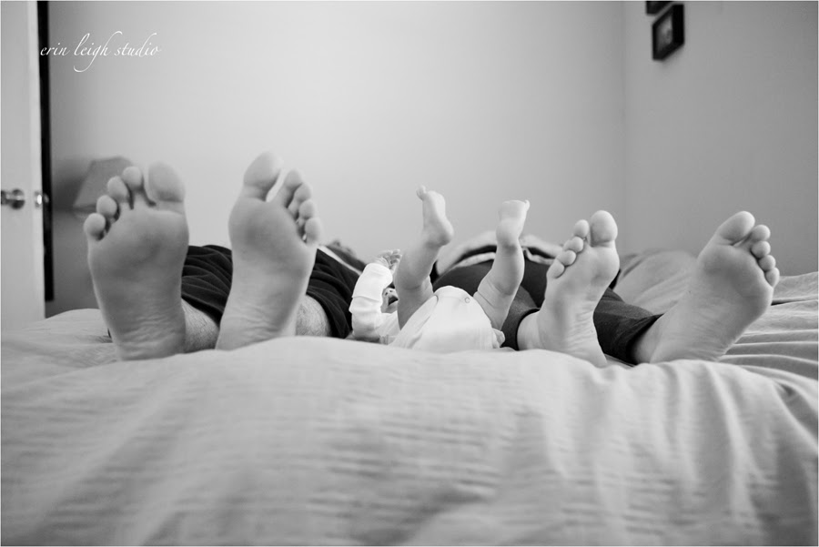 newborn feet with mom and dad feet