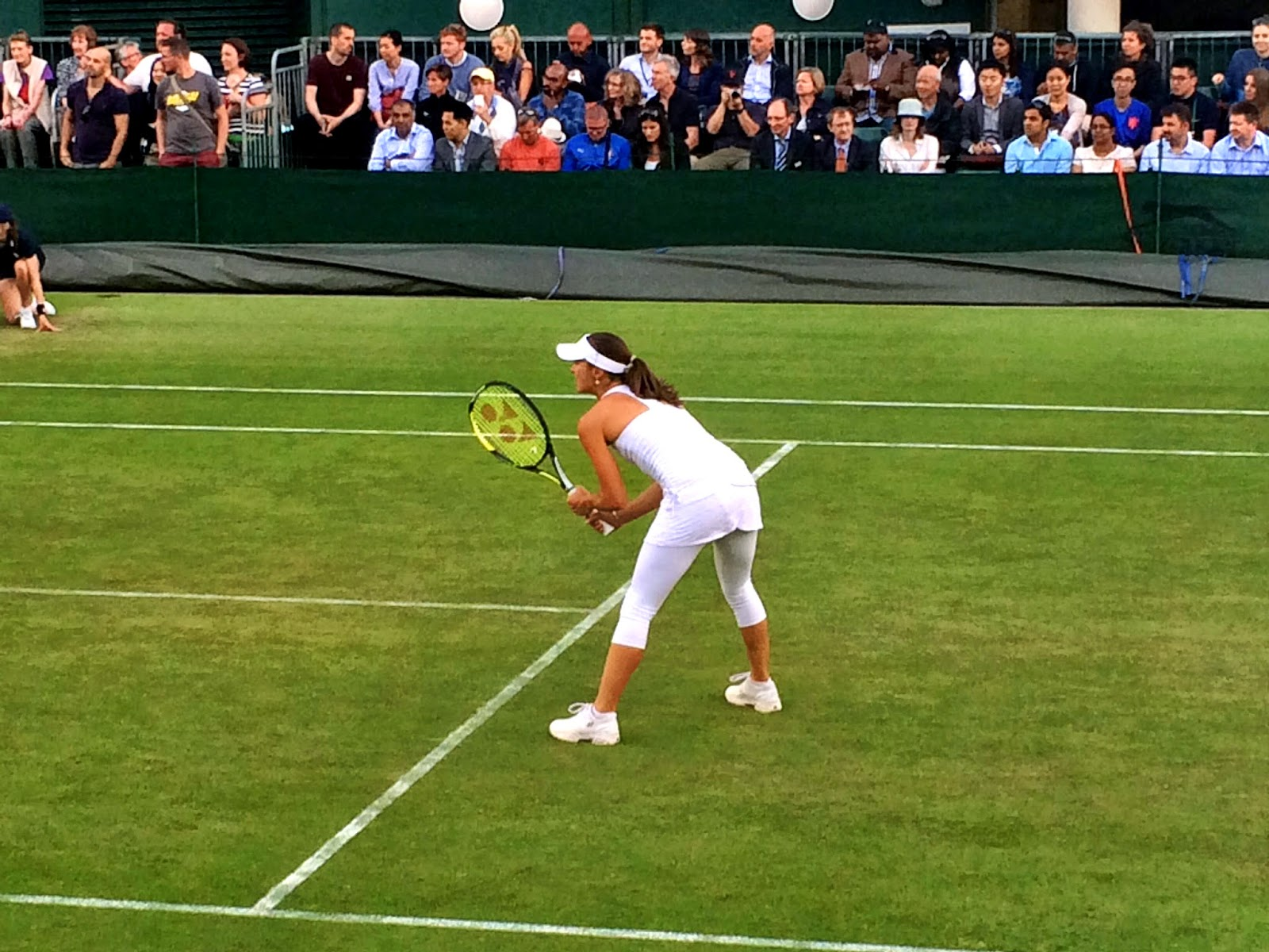 Martina Hingis playing at Wimbledon 2014