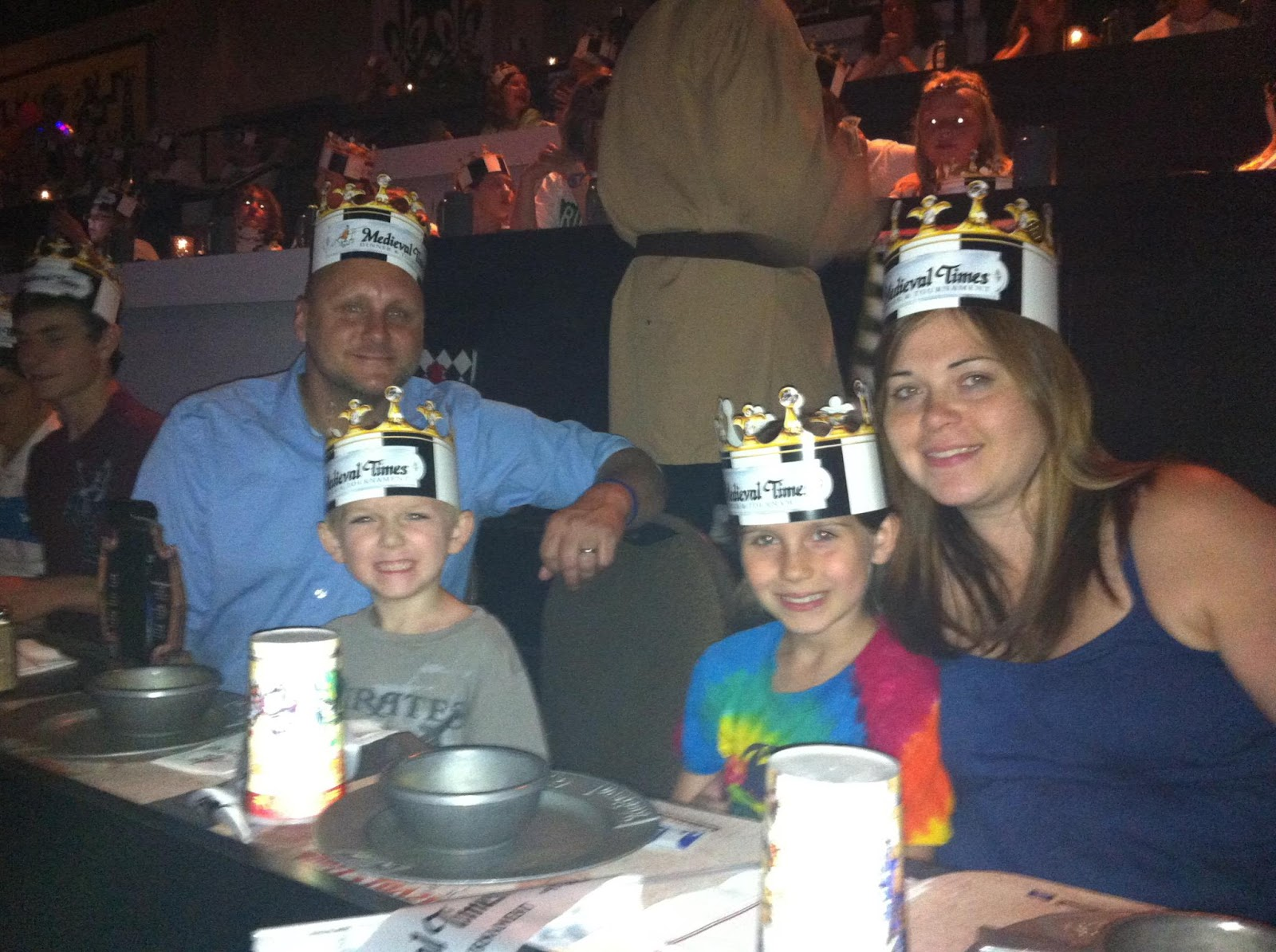 Medieval times is a franchise dinner theatre with a medieval theme. You eat a medieval style banquet in a large arena while being entertained by a show.