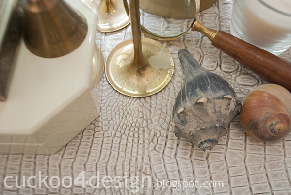 alligator skin fabric with sea shells and brass candles