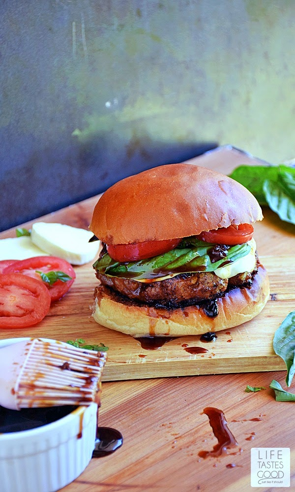 Balsamic Burgers | by Life Tastes Good are grilled to juicy perfection while basting with a sweet and tangy balsamic glaze, and topped with tasty tomatoes, fresh basil leaves, as well as creamy mozzarella cheese for an Italian inspired burger I could eat every day!